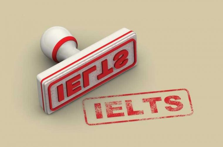 "Red seal and imprint ""IELTS"" on white surface"